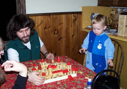 Father building Spanish castle with son.